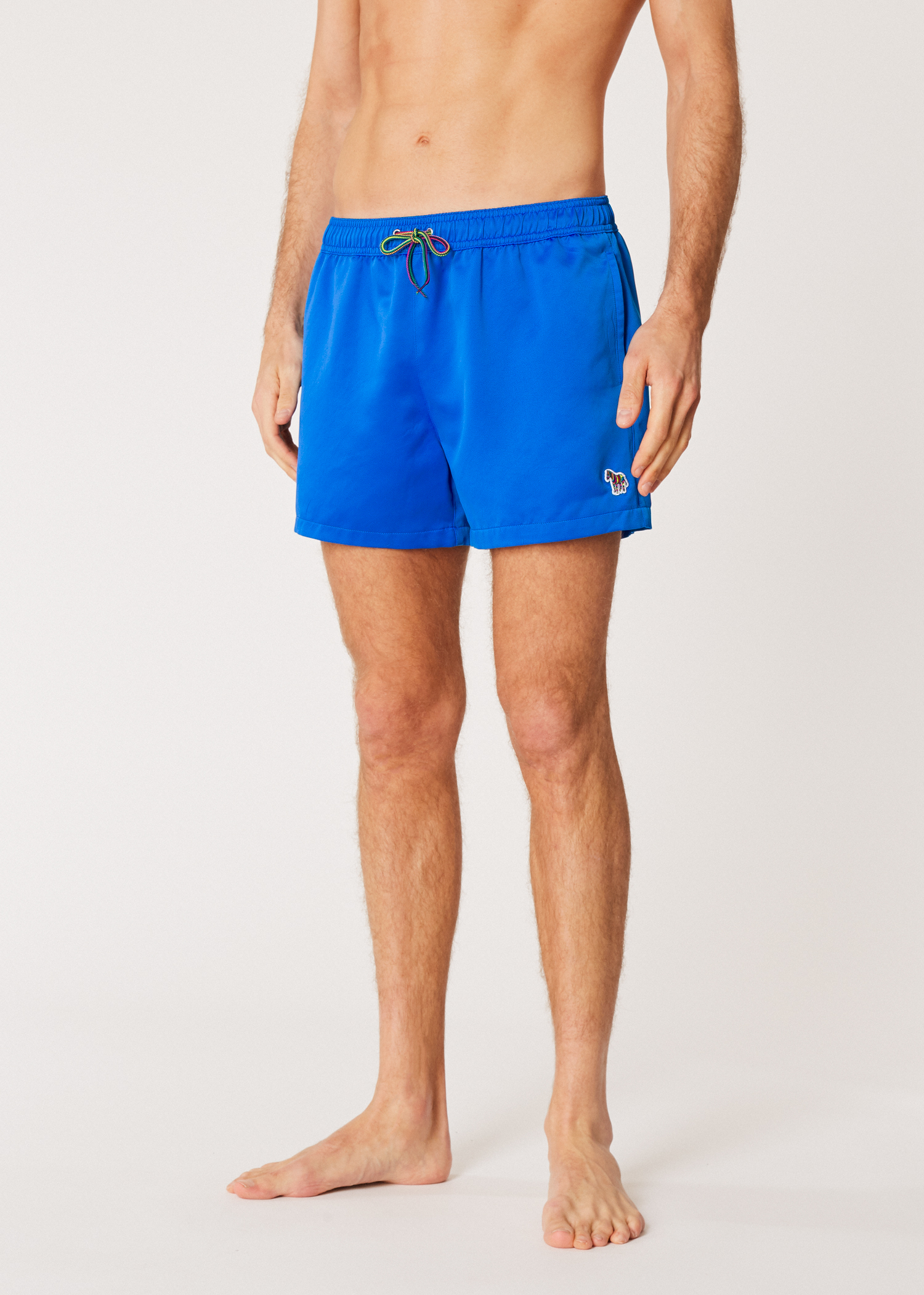 31f7e1c362 Model front view- Men's Blue Zebra Logo Swim Shorts by Paul Smith