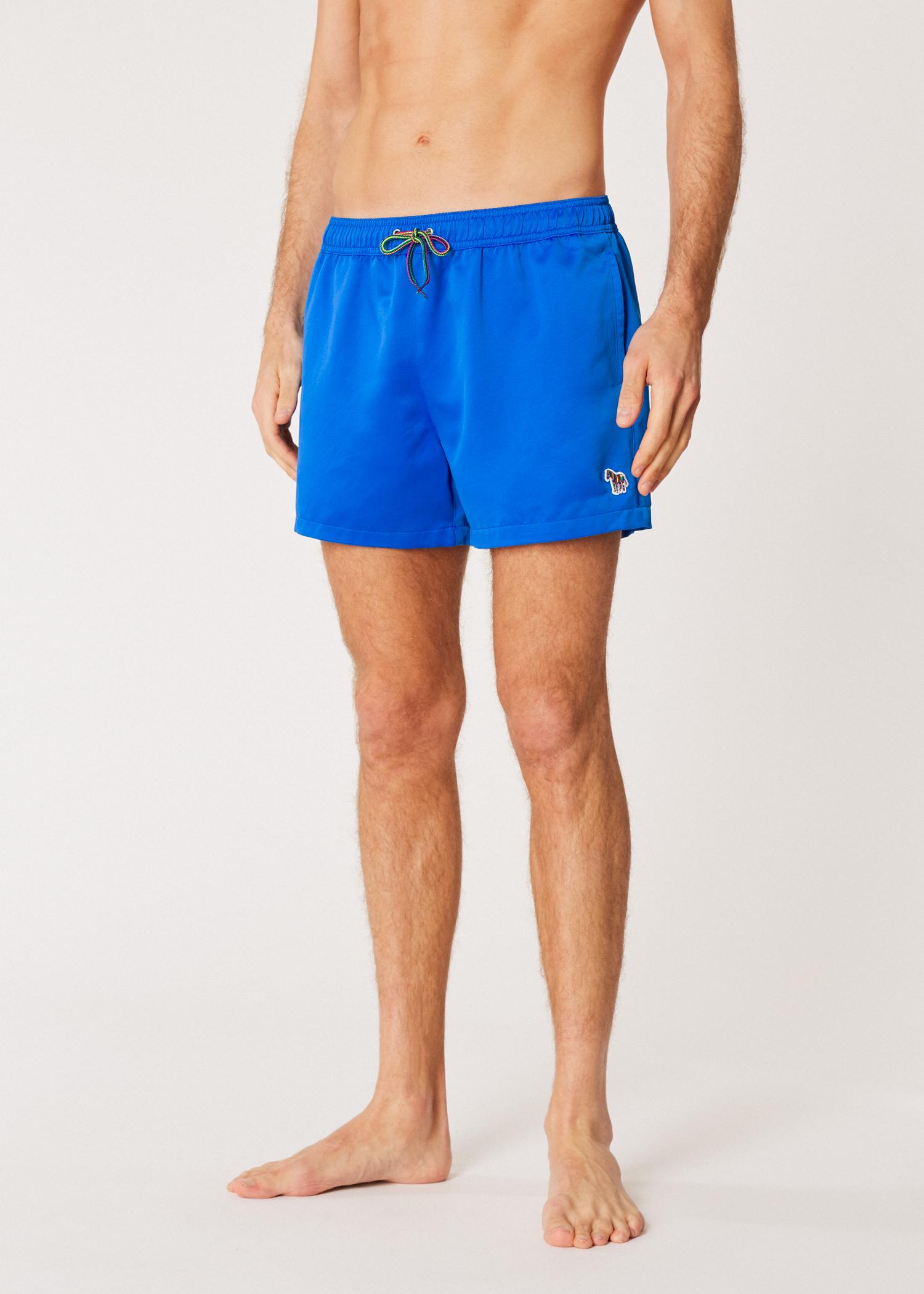 3d293cd45b20a Model front view- Men's Blue Zebra Logo Swim Shorts by Paul Smith