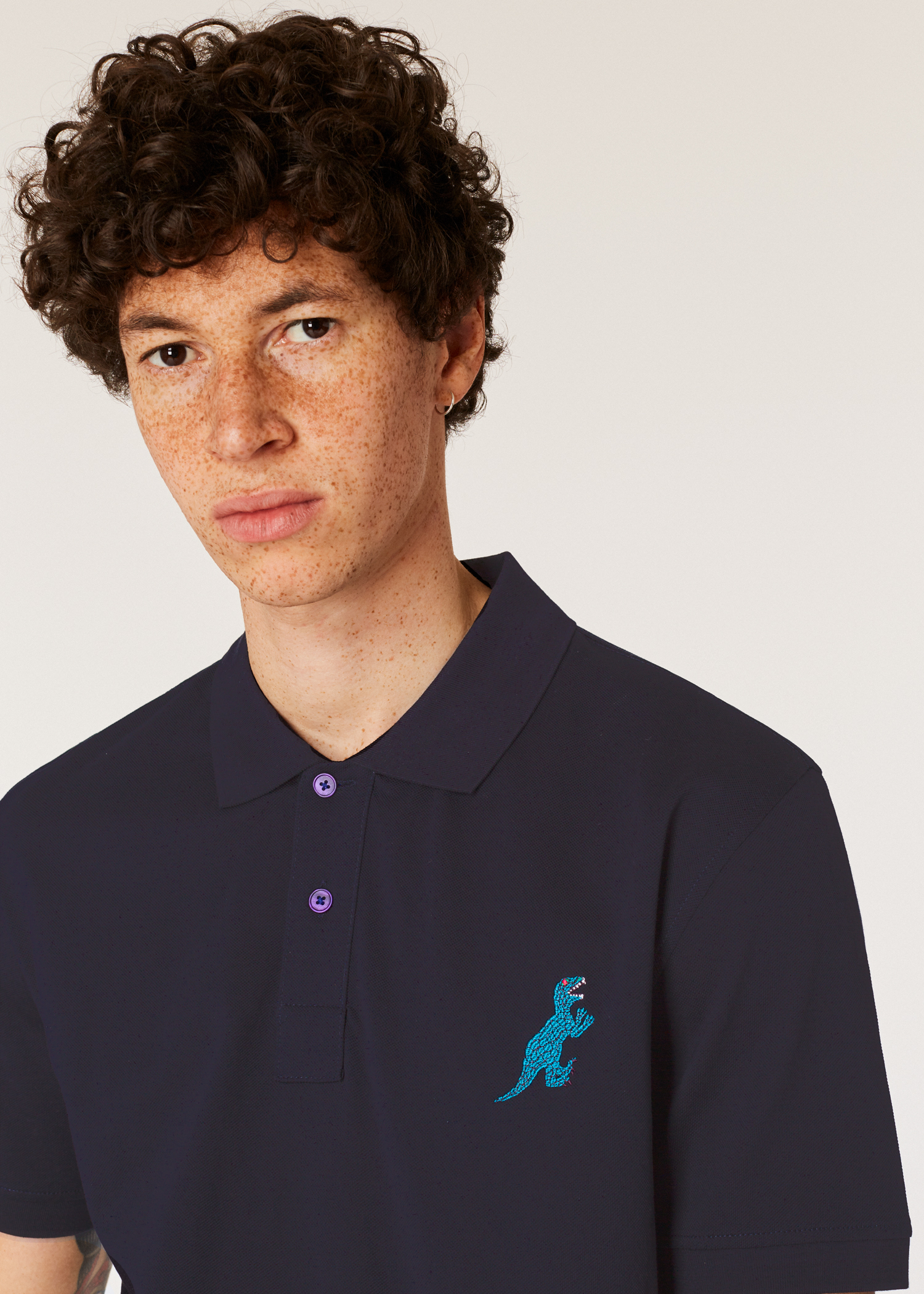 ddc4bc71c Model front close up - Men s Regular-Fit Dark Navy Embroidered  Dino  Polo