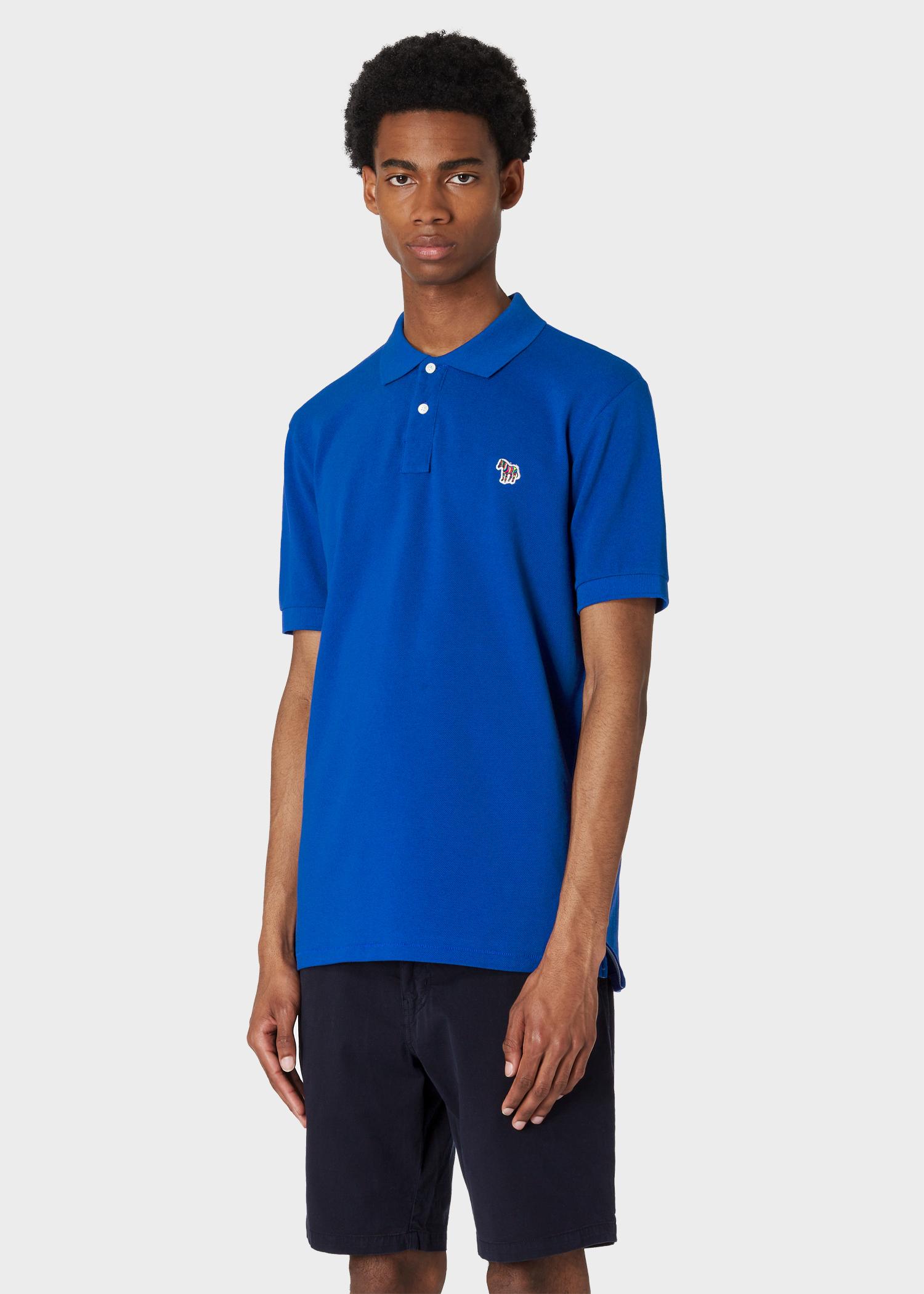 a51c23bc Model front close up - Men's Indigo Organic Cotton-Piqué Zebra Logo Polo  Shirt Paul