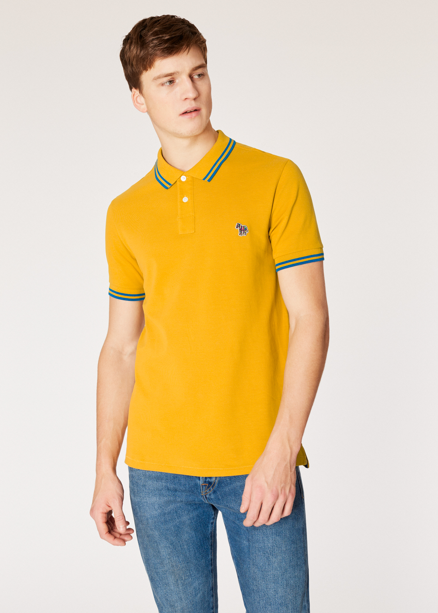 1093c4a6 Model front close up - Men's Slim-Fit Mustard Zebra Polo Shirt With Blue  Tipping