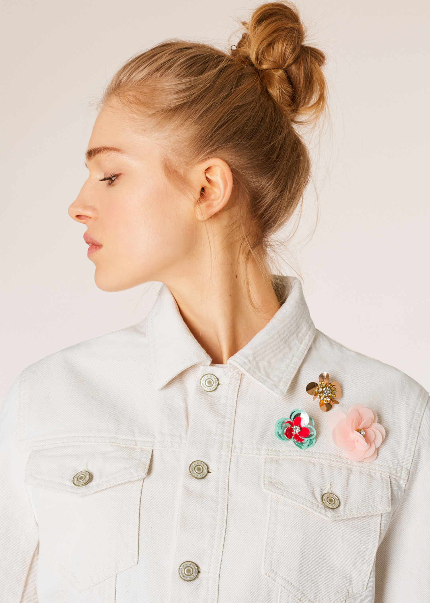 5d352b0dfd9 Model front detail shot- Women's White Denim Jacket With Flower  Embellishments Paul Smith